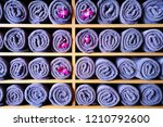 blue towels on the shelf in the ... | Shutterstock . vector #1210792600