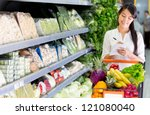 woman with a shopping list for...   Shutterstock . vector #121080040