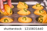 Stock photo step by step taking out freshly baked spicy jalapeno cornbread muffins from metal muffin pan 1210831660