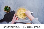 Stock photo step by step flat lay mixing ingredients together in glass mixing bowl for spicy jalapeno 1210831966