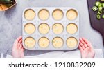 Stock photo step by step flat lay filling metal muffin pan with cornbread batter to bake spicy jalapeno 1210832209