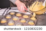 Stock photo step by step filling metal muffin pan with cornbread batter to bake spicy jalapeno cornbread 1210832230