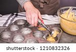 Stock photo step by step filling metal muffin pan with cornbread batter to bake spicy jalapeno cornbread 1210832326