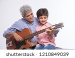 grandfather and grandson... | Shutterstock . vector #1210849039