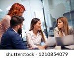 business team working together... | Shutterstock . vector #1210854079
