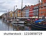 Small photo of Copenhagen/Denmark - August 24 2018 : Nyhavn is a waterfront district in Copenhagen, Denmark. Today is a sunny day so people come here to enjoin eating food and drinking with their friends and family.