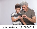 grandfather and grandson using... | Shutterstock . vector #1210866019