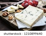 slice of gorgonzola cheese on... | Shutterstock . vector #1210899640