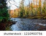 autumn forest river landscape...   Shutterstock . vector #1210903756