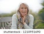 beautiful senior womam sitting...   Shutterstock . vector #1210951690
