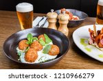 five croquettes in a black bowl ... | Shutterstock . vector #1210966279