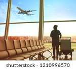 single woman sitting in airport ... | Shutterstock . vector #1210996570