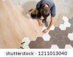 male worker installing new... | Shutterstock . vector #1211013040