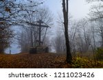 autumn forest mist cross view.... | Shutterstock . vector #1211023426