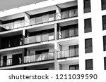 modern apartment buildings.... | Shutterstock . vector #1211039590