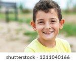 portrait of happy smiling child ...   Shutterstock . vector #1211040166