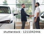 close up of car headlight. men... | Shutterstock . vector #1211042446