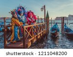 colorful carnival masks at a...   Shutterstock . vector #1211048200