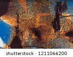 different colors on rusty blue... | Shutterstock . vector #1211066200
