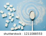 sugar cubes and spoon on the... | Shutterstock . vector #1211088553