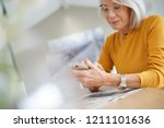 modern senior woman on... | Shutterstock . vector #1211101636