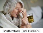 senior woman at home feeling... | Shutterstock . vector #1211101873