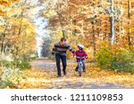 little preschool kid boy and... | Shutterstock . vector #1211109853