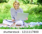 woman with laptop sit on rug... | Shutterstock . vector #1211117800