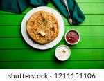 aloo paratha   indian potato... | Shutterstock . vector #1211151106