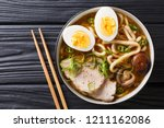 asian style soup with udon... | Shutterstock . vector #1211162086