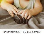 baby and digital cameras in...   Shutterstock . vector #1211165980