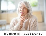 happy senior woman sitting at... | Shutterstock . vector #1211172466
