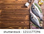 raw dorado fish and ingridient... | Shutterstock . vector #1211177296