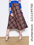 women leg in stripy sweater and ... | Shutterstock . vector #1211199700