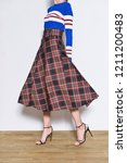 women leg in stripy sweater and ... | Shutterstock . vector #1211200483