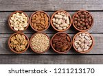 mix of nuts   pistachios ... | Shutterstock . vector #1211213170