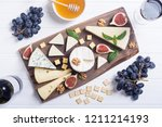 cheeseboard with cheese brie  ... | Shutterstock . vector #1211214193
