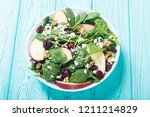 autumn spinach salad with apple ... | Shutterstock . vector #1211214829