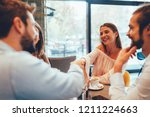 friends hang out in a cafe | Shutterstock . vector #1211224663