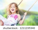 little child blond girl having... | Shutterstock . vector #1211235340