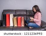 happy woman using laptop... | Shutterstock . vector #1211236993