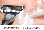a man shaves the machine...   Shutterstock . vector #1211239393