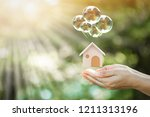 woman hand hold a home model... | Shutterstock . vector #1211313196