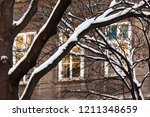 snow covered branches in front... | Shutterstock . vector #1211348659