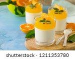 panna cotta with tangerines... | Shutterstock . vector #1211353780