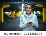 female using phone and...   Shutterstock . vector #1211368276