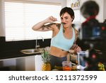 fit young woman testing... | Shutterstock . vector #1211372599