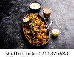 homemade kothu parotta  paratha ... | Shutterstock . vector #1211375683