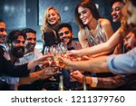 young people celebrating with... | Shutterstock . vector #1211379760