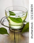 glass cup with fresh green tea | Shutterstock . vector #121138654